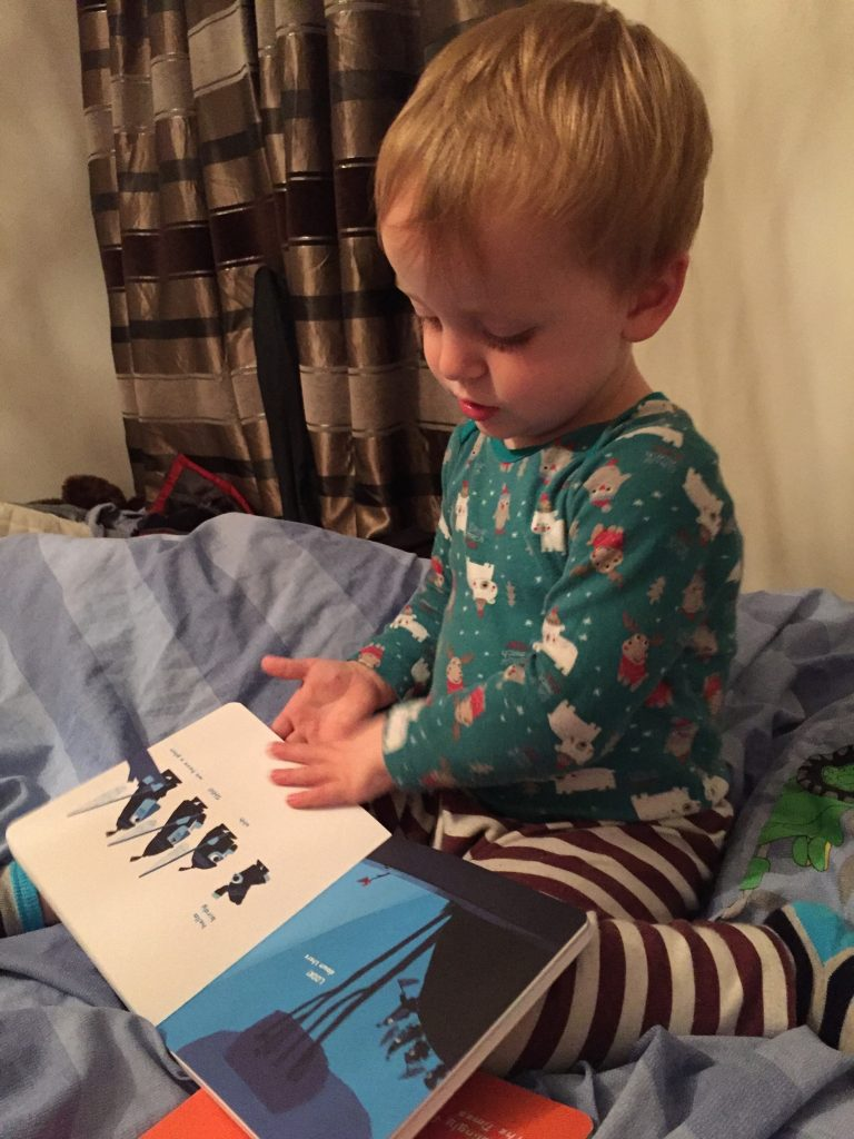 Toddler reading Chris Houghton Shh We Have a Plan - Favourite Bedtime Stories - BadMammy.com